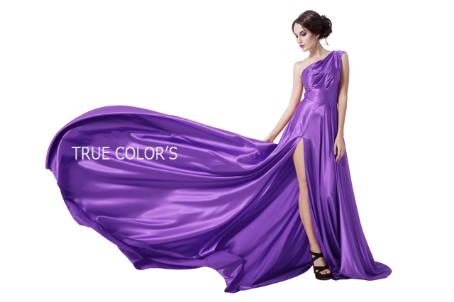 Young Beauty Woman In Fluttering Violet Dress. Isolated On White